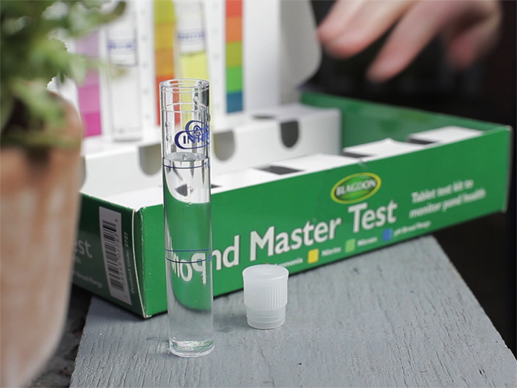 Green box with colour charts and plastic vials